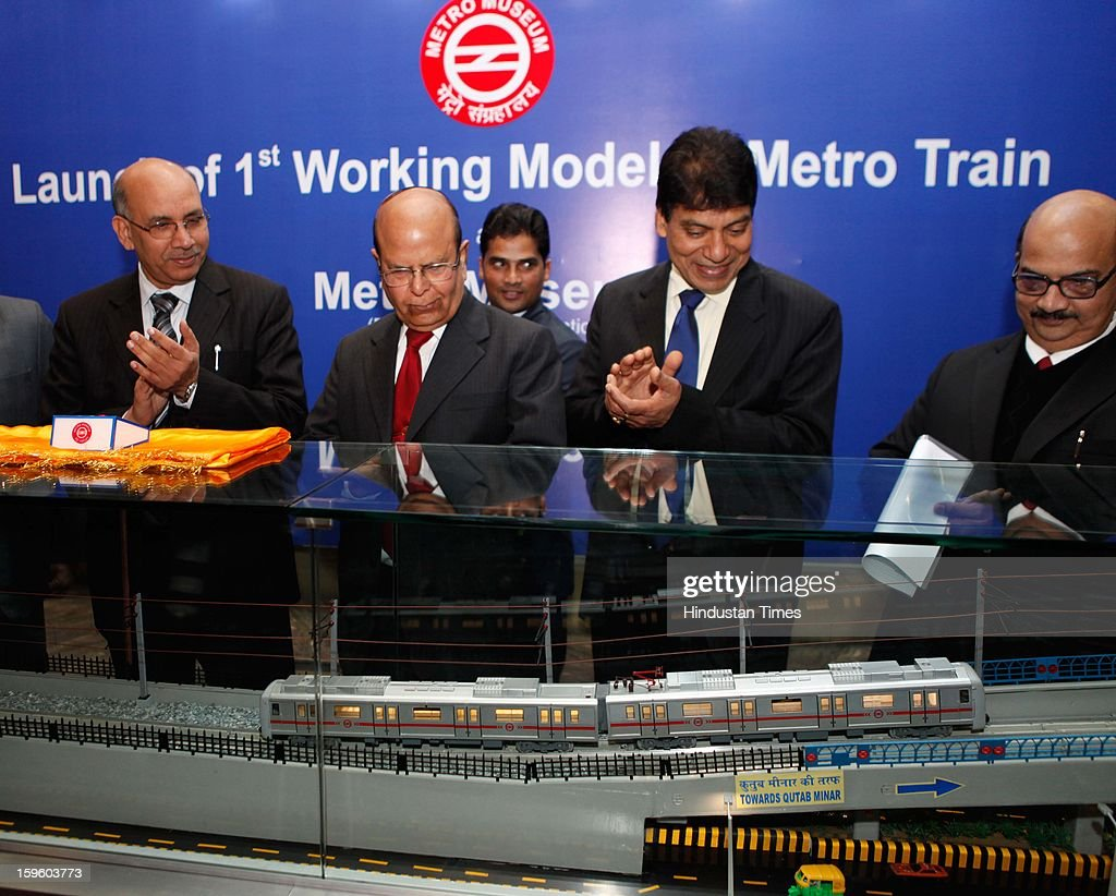 Mangu Singh, DMRC Managing Director along with other officials unveiling a working model of the Metro Train displaying its movements through underground, elevated and at grade corridors at the Delhi Metro Museum at Patel Chowk Metro station on January 17, 2013 in New Delhi, India.