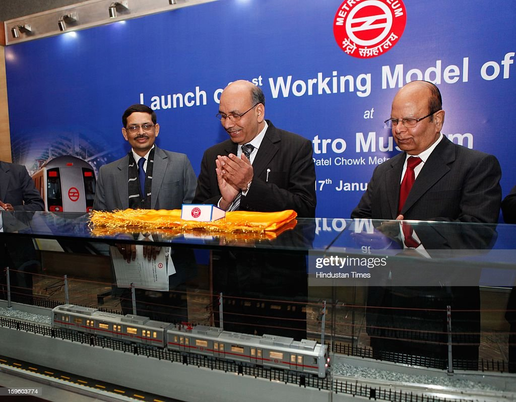 Mangu Singh, DMRC Managing Director, along with other officials unveiling a working model of the Metro Train displaying its movements through underground, elevated and at grade corridors at the Delhi Metro Museum at Patel Chowk Metro station on January 17, 2013 in New Delhi, India.