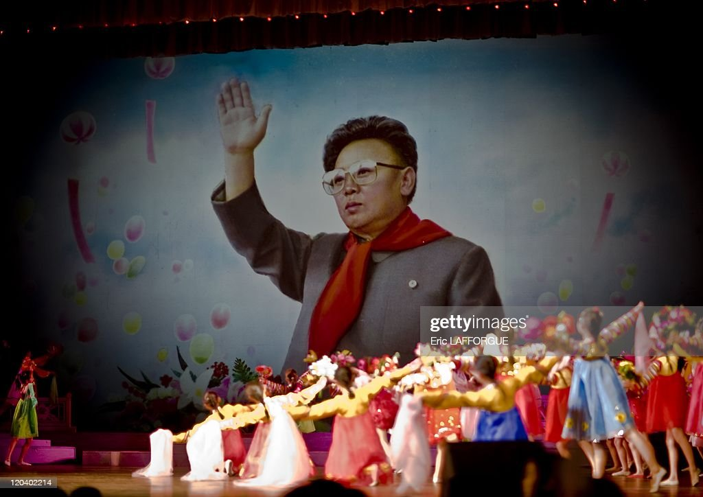 Mangyongdae theatre in Pyongyang North Korea on April 17 2008 End of Mangyongdae School children's palace show with the giant picture of Kim Jong Il...