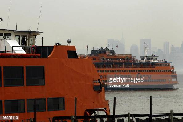 Manhattan bound Staten Island Ferry passes the Andrew J Barbieri ferry following the crash of the Barbieri into a dock in the city's borough of...