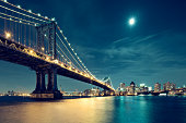 Manhattan Bridge in night with moon