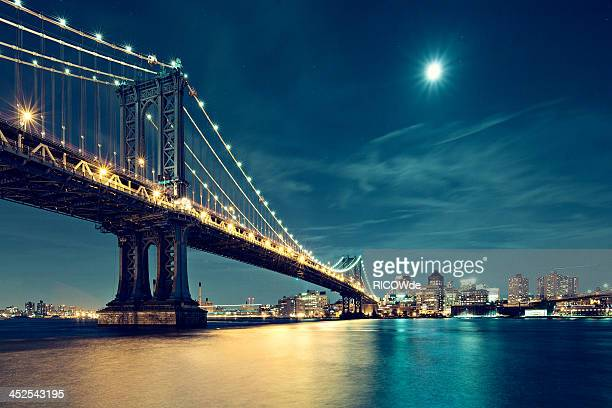 Manhattan Bridge in night with moon
