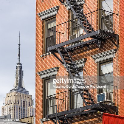 Manhattan, Chelsea, typical building and the Empire State Building on the background : Stock Photo