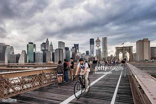 Manhattan, people and bicycles on Brooklyn Bridge