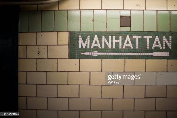 Manhattan sign made of old tile on subway wall in New York New York USA