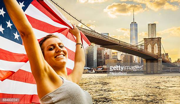 Manhattan skyline at sunset, American Young Woman in the foreground
