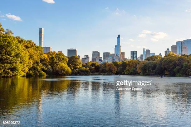 Manhattan skyline with lake in the Central Park, New York, United States