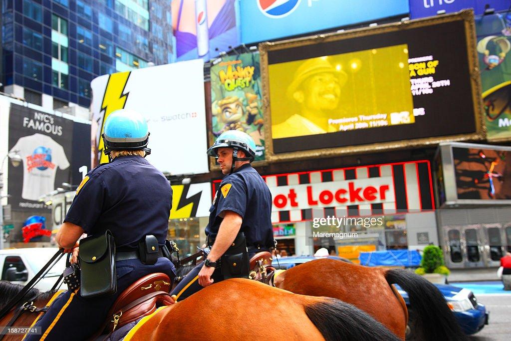 Manhattan, Times square, policemen riding horses : Stock Photo