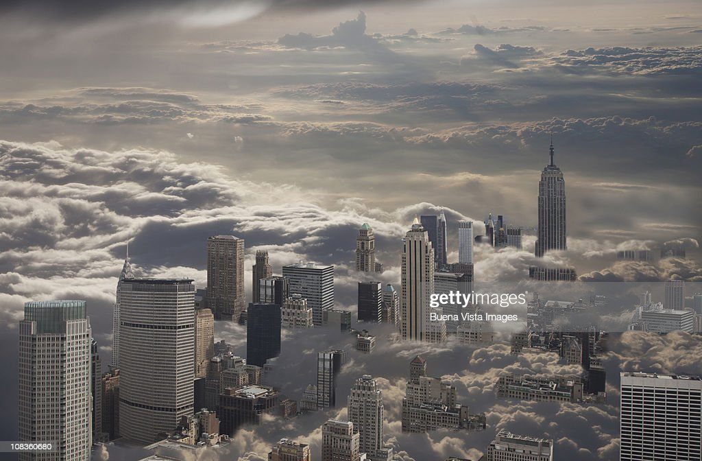 Manhattan under cloudy sky : Stock Photo