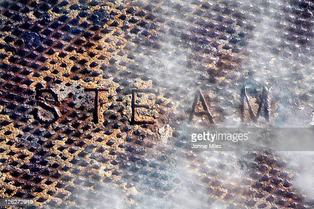 Manhole cover with steam