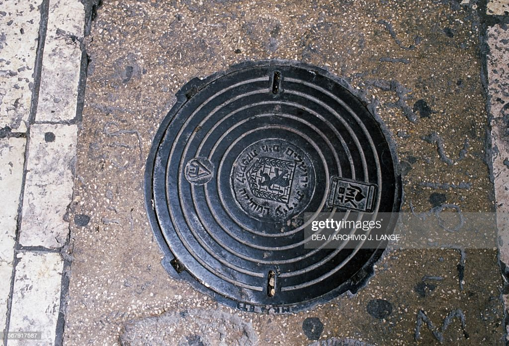 Manhole on Hagai street in the Muslim quarter Old City of Jerusalem Israel