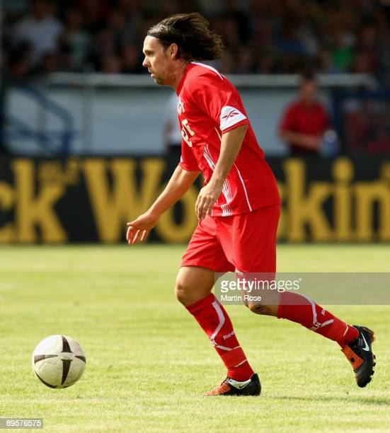 Maniche of Koeln runs with the ball during the DFB Cup first round match between BSV Kickers Emden and 1 FC Koeln at the Embdena stadium on August 1...