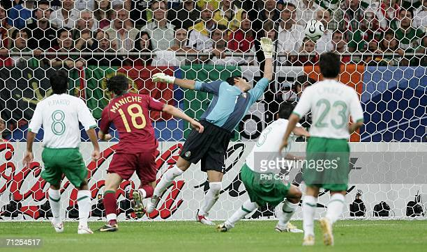 Maniche of Portugal shoots and scores the first goal of the game past goalkeeper Oswaldo Sanchez of Mexico during the FIFA World Cup Germany 2006...