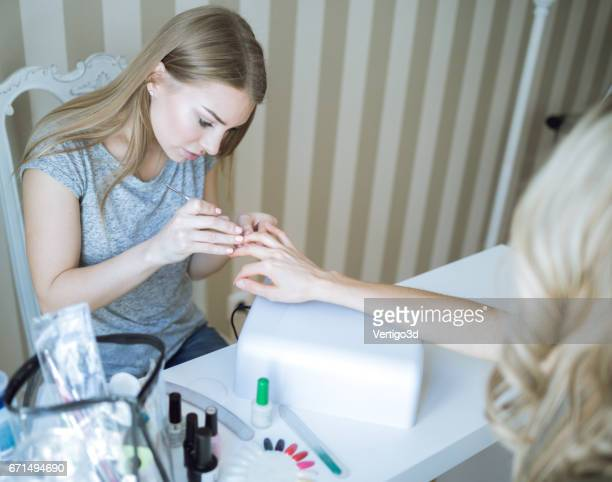 Manicure master and client