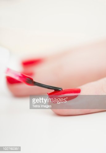Manicure with red nail polish