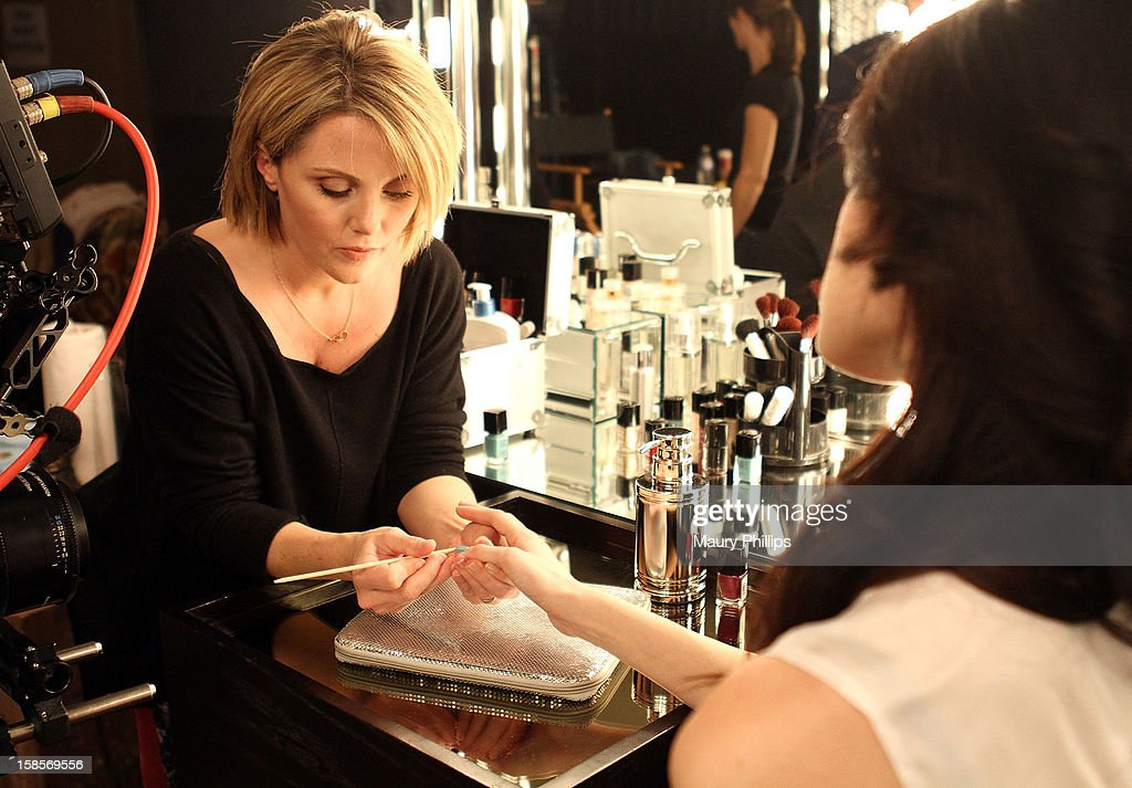 Manicurist April Forman and model Linda Higgins on set during Behind The Beauty Documentary - Day 2 at The Redbury Hotel on December 19, 2012 in Hollywood, California.