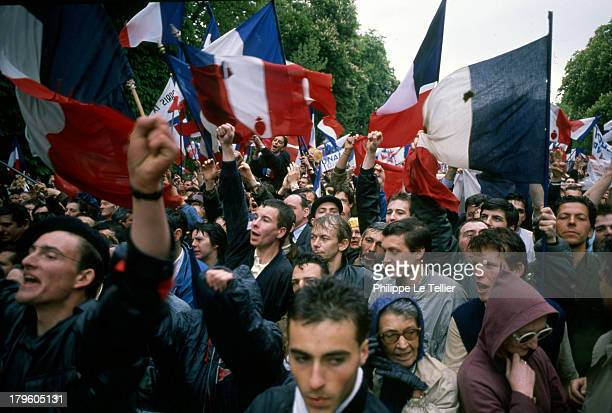 Manifestation of Le Pen and National Front before the statue of Jeanne d'Arc in Paris Jean Marie Le Pen Bruno Megret Jean Marie Stirbois 1 May 1988...