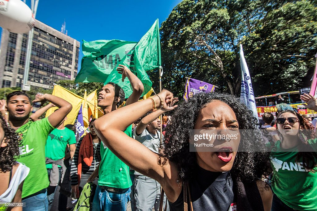 Manifestations of socialist movements celebrate Labor Day in Sao Paulo Avenue in Sao Paulo on Sunday, 1 in Brazil. They ask for the departure of President Dilma Rousseff and Vice President Michel Temer and want general elections.