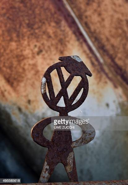 A manikin with the logo of German car maker Volkswagen is seen on the bumper bar of a rusty vintage VW beetle car at a workshop in Usseln western...