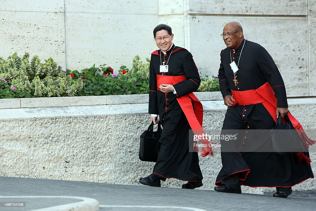 Manila Archbishop Cardinal <a gi-track='captionPersonalityLinkClicked' href=/galleries/search?phrase=Luis+Antonio+Tagle&family=editorial&specificpeople=9615781 ng-click='$event.stopPropagation()'>Luis Antonio Tagle</a> (L) arrives at the Synod Hall for the opening of the Synod on the themes of family on October 6, 2014 in Vatican City, Vatican. The two week General Assembly will discuss the 'The Pastoral Challenges of the Family in the Context of the Evangelization'.