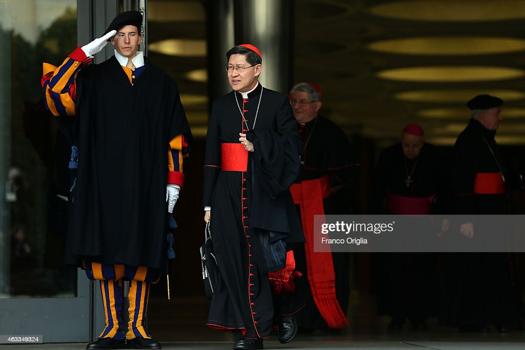 Manila Archbishop Cardinal <a gi-track='captionPersonalityLinkClicked' href=/galleries/search?phrase=Luis+Antonio+Tagle&family=editorial&specificpeople=9615781 ng-click='$event.stopPropagation()'>Luis Antonio Tagle</a> (C) leaves the Synod Hall at the end of the Extraordinary Consistory for the creation of new cardinals on February 13, 2015 in Vatican City, Vatican. Reform of the Curia, is at the centre of the Extraordinary Consistory which included the 20 prelates who will be created Cardinals on Saturday.