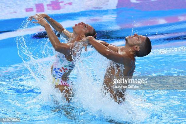 Manila Flamini of Italy and Giorgio Minisini of Italy competes during the Mixed Duet Synchro Technical Preliminary Round on day two of the Budapest...