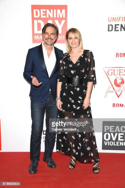 Manila Nazzaro and Beppe Convertini attend the Guess Foundation Denim Day 2017 at Palazzo Barberini on May 4 2017 in Rome Italy