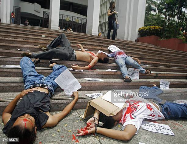 Filipino student activists lay on the ground acting as dead bodies at the University of the Philippines a Major state univertisy in suburban Quezon...