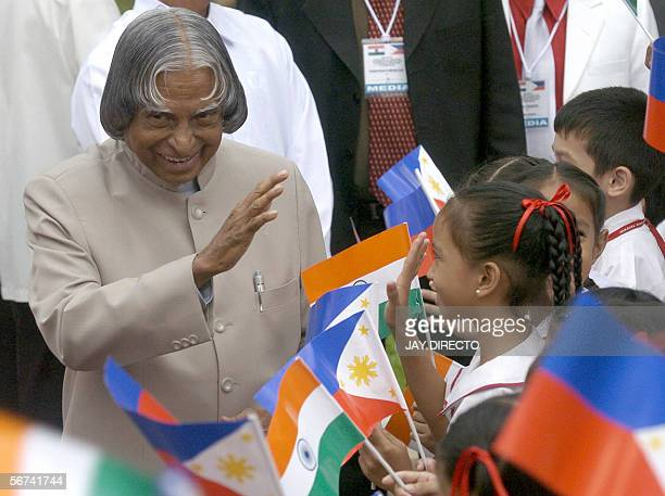 Indian President Abdul Kalam waves to children after the arrival honors at the Philippine presidential palace in Manila 04 February 2006 Kalam...