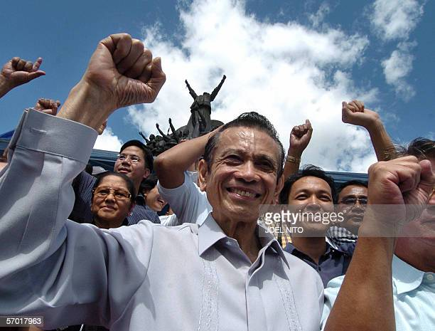Opposition figures led by former vicepresident Teofisto Guingona attend a demonstration infront of the 'people power' monument in Manila 16 February...