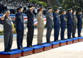 The 10 chiefs of the air forces of the member nations of the Association of Southeast Asian Nations salute during a ceremony marking the 60th...
