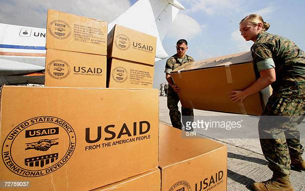 US soldiers carry relief supplies to the Philippines worth nearly 130000 USD at the International airport in Manila 07 December 2006 to help in the...