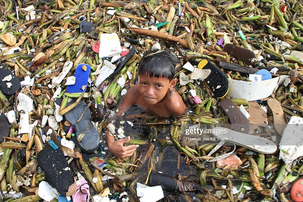 Manila, Tondo, New Smokey Mountain, Ulingan, Charcoal Factory, Philippines, garbage, rubbish, sea, water, bath, dirt, smelly, boy, kid, child, swim