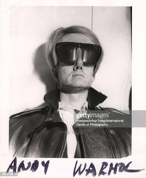 Manipulated image of American pop artist and filmmaker Andy Warhol in a leather jacket and sunglasses based on a previous portrait 1960 Photo by...