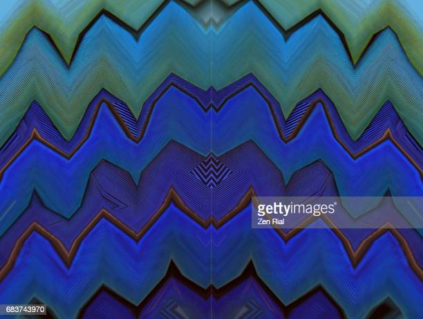 Manipulated image of bird feathers in symmetrical vibrant blue tones in zigzag design