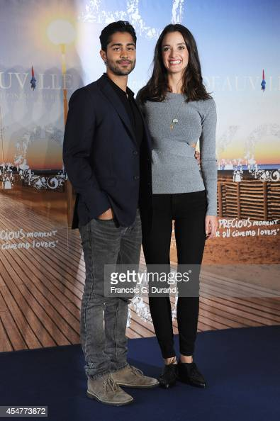 Manish Dayal and Charlotte Le Bon pose at a photocall during the 40th Deauville American Film Festival on September 6 2014 in Deauville France