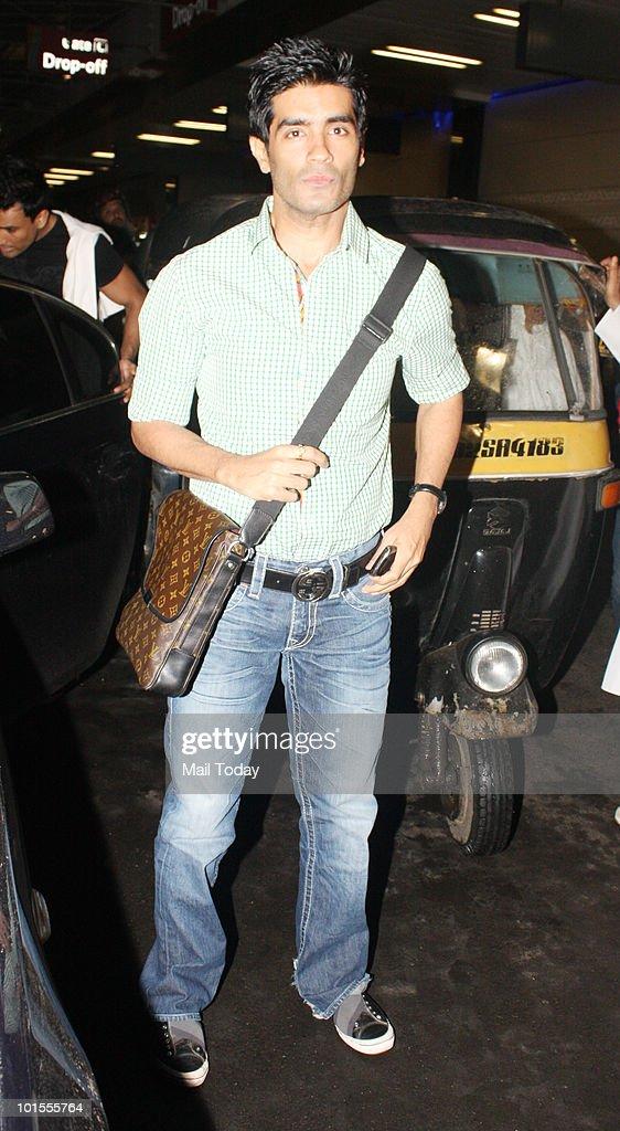 Manish Malhotra at the Mumbai airport in Mumbai on May 31, 2010.