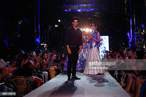 Manish Malhotra walks the runway during day 1 of Lakme Fashion Week Summer/Resort 2015 at The New Great Eastern Mills on March 18 2015 in Mumbai India