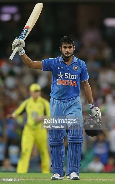 Manish Pandey of India celebrates and acknowledges the crowd after scoring a century during game five of the Commonwealth Bank One Day Series match...