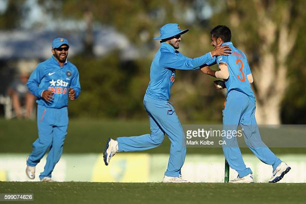 Manish Pandey of India congratulates Yuzvendra Chahal of India A after he took the wicket of Kane Richardson of Australia during the Cricket...