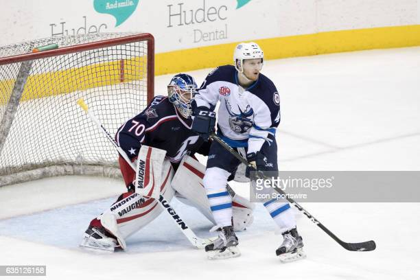 Manitoba Moose LW Kyle Connor looks for a pass in front of Cleveland Monsters G Joonas Korpisalo during the third period of the AHL hockey game...