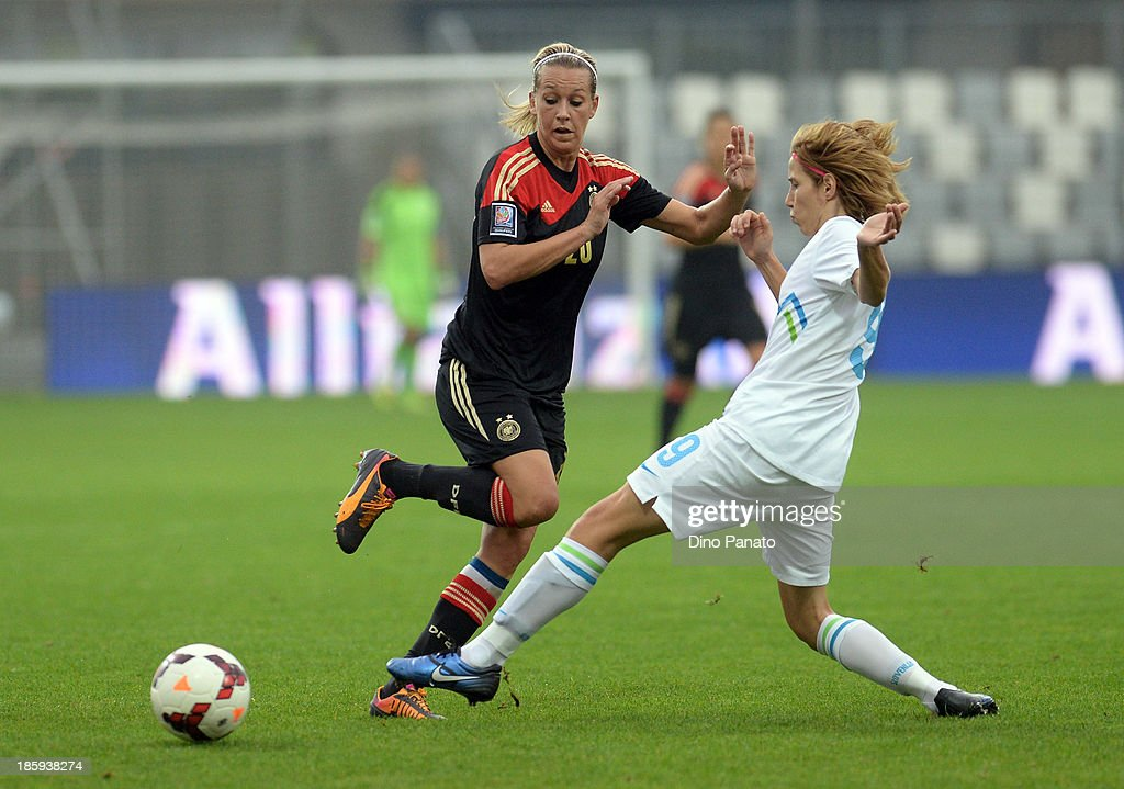 Manja Benak (R) of Slovenia competes with Lena Goessling of Germany during the Qualifying Round - FIFA Women's World Cup between Slovenia and Germany at SRC Bonifika stadio on October 26, 2013 in Koper, Slovenia.