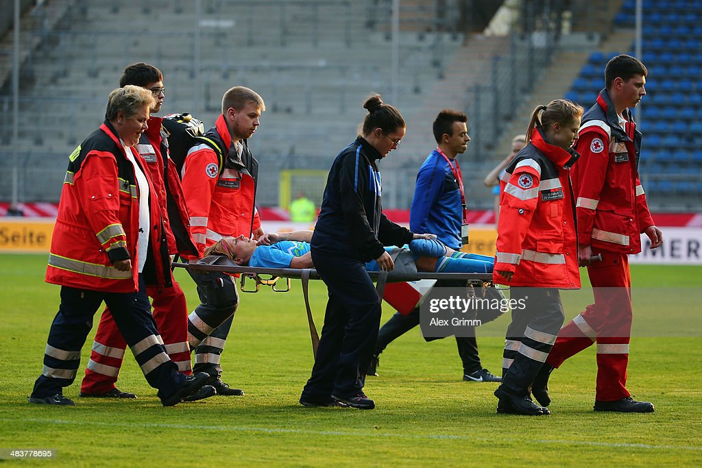 Manja Benak of Slovenia is carried off on a stretcher during the FIFA Women's World Cup 2015 qualifying match between Germany and Slovenia at Carl-Benz-Stadion on April 10, 2014 in Mannheim, Germany.