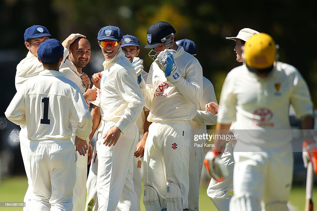 Manjot Singh and Jay Lenton of New South Wales celebrate the wicket of Ryan James of Western Australia during day one of the Futures League match between Western Australia and New South Wales at Richardson Park on October 14, 2013 in Perth, Australia.