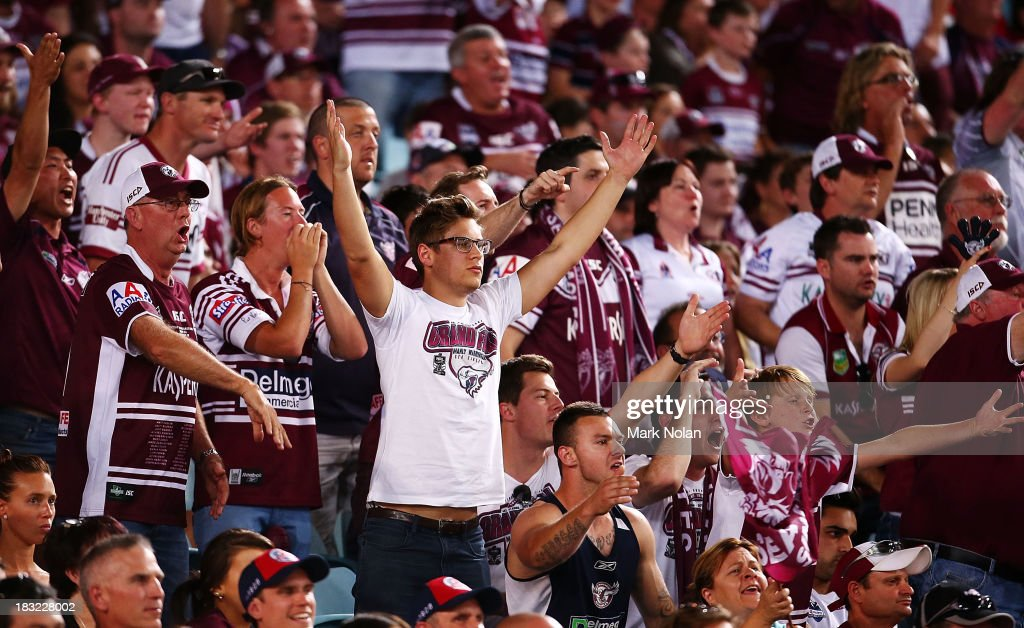 Manly fans react to a referee's decision during the 2013 NRL Grand Final match between the Sydney Roosters and the Manly Warringah Sea Eagles at ANZ Stadium on October 6, 2013 in Sydney, Australia.