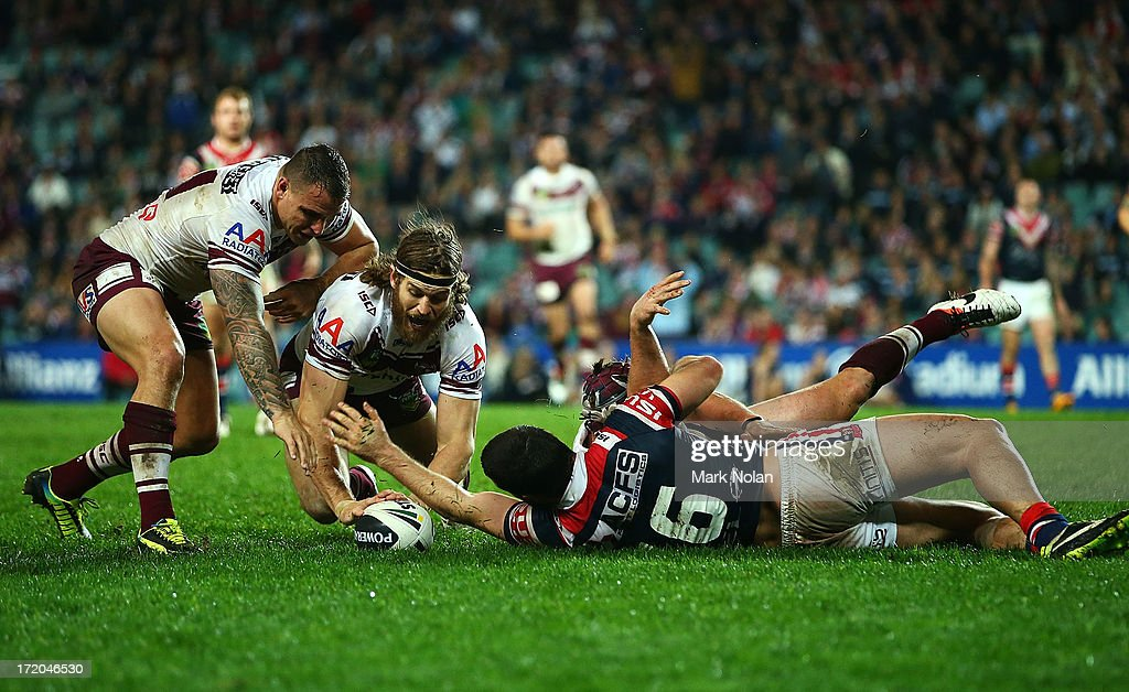Manly players scramble for the ball after Jamie Buhrer was denied a try by the defence of Aidan Guerra of the Roosters during the round 16 NRL match between the Sydney Roosters and the Manly Sea Eagles at Allianz Stadium on July 1, 2013 in Sydney, Australia.