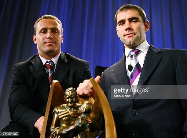 Manly Sea Eagles captain Matt Orford and Melbourne Storm captain Cameron Smith pose with the NRL Premiership trophy during the 2007 NRL Grand Final...
