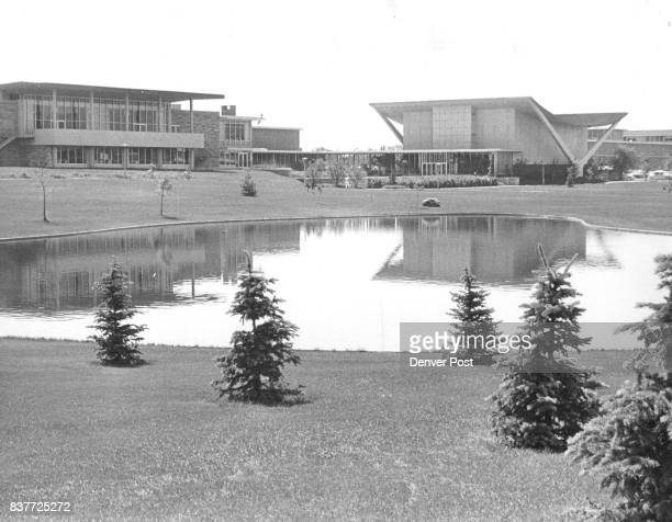 A manmade pond in the foreground and young trees just starting to grow enhance the beauty of Colorado State University's new architecture seen in the...