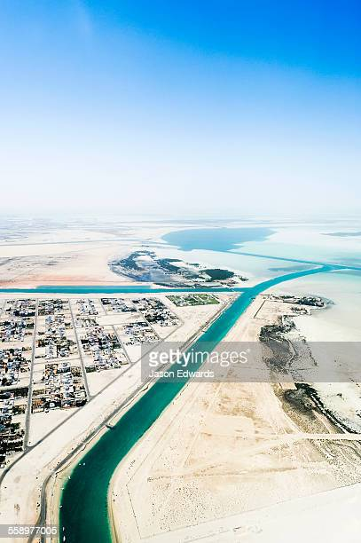 Manmade turquoise channels lead from the ocean to suburban residential estates and homes.