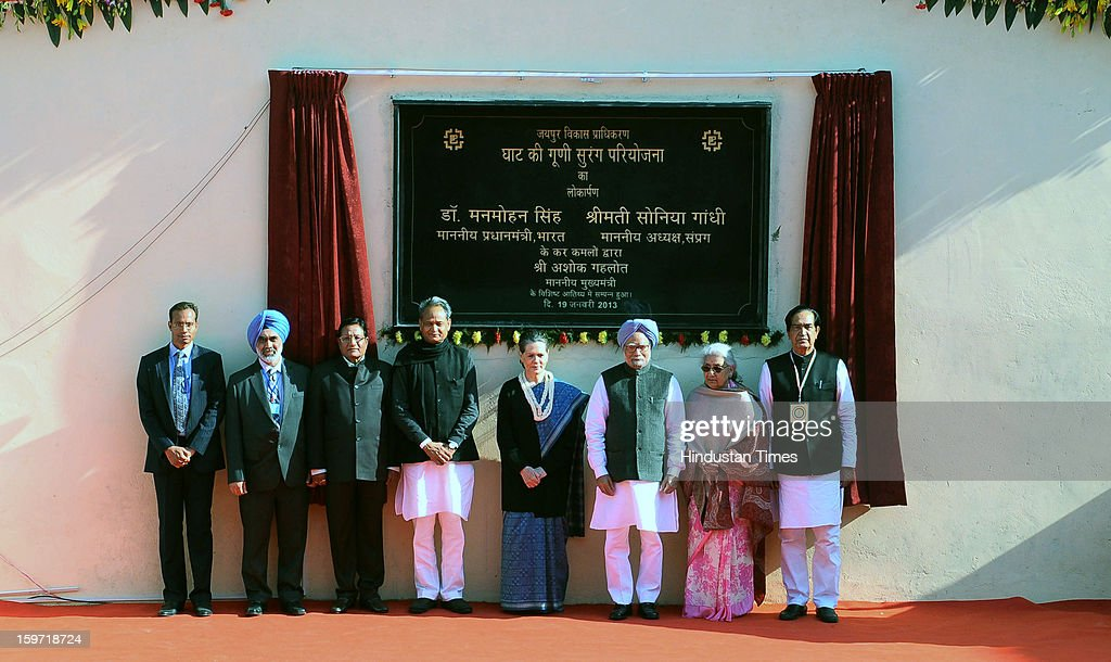 PM Manmohan Singh ( 3 R) and UPA Chairperson and Congress President Sonia Gandhi (4 R) along with Rajasthan CM Ashok Gehlot (5 R) Union Ministers Chandresh Kumari (2 R) and Namo Narayan Meena (R) dedicate the Ghat Ki Guni Project Tunnel to public on January 19, 2013 in Jaipur, India. With a combined length of 2,800 metres, the twin-tube tunnel, bored through Jhalana hills at a cost of Rs 150 crore, would help ease traffic congestion on the existing connector and systematize vehicular flow at the Eastern Gateway of the city.